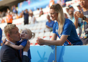 NICE, FRANCE - JUNE 27: Kolbeinn Sigthorsson of Iceland greets his wife and daughter before the match during the UEFA EURO 2016 Round of 16 match between England and Iceland at Allianz Riviera Stadium on June 27, 2016 in Nice, France. (Photo by Catherine Ivill - AMA/Getty Images)