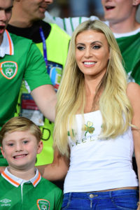 Claudine Palmer, wife of Robbie Keane of Republic of Ireland, and their son Robert during the UEFA EURO 2016 Group E match between Italy and Republic of Ireland at Stade Pierre-Mauroy on June 22, 2016 in Lille, France. (Photo by Dave Winter/Icon Sport) (Photo by Dave Winter/Icon Sport via Getty Images)