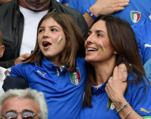 Elisabetta Muscarello (R), wife of Antonio Conte head coach of Italy, and Vittoria Conte, daughter of Antonio Conte, smile in the stand prior to the UEFA EURO 2016 round of 16 match between Italy and Spain at Stade de France on June 27, 2016 in Paris, France